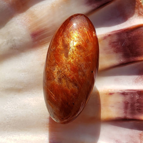 Radiant Sunstone Palm Stone Lingam
