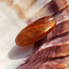 Luminous Sunstone Palm Stone Lingam