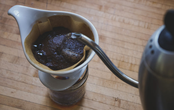 Water pouring over coffee