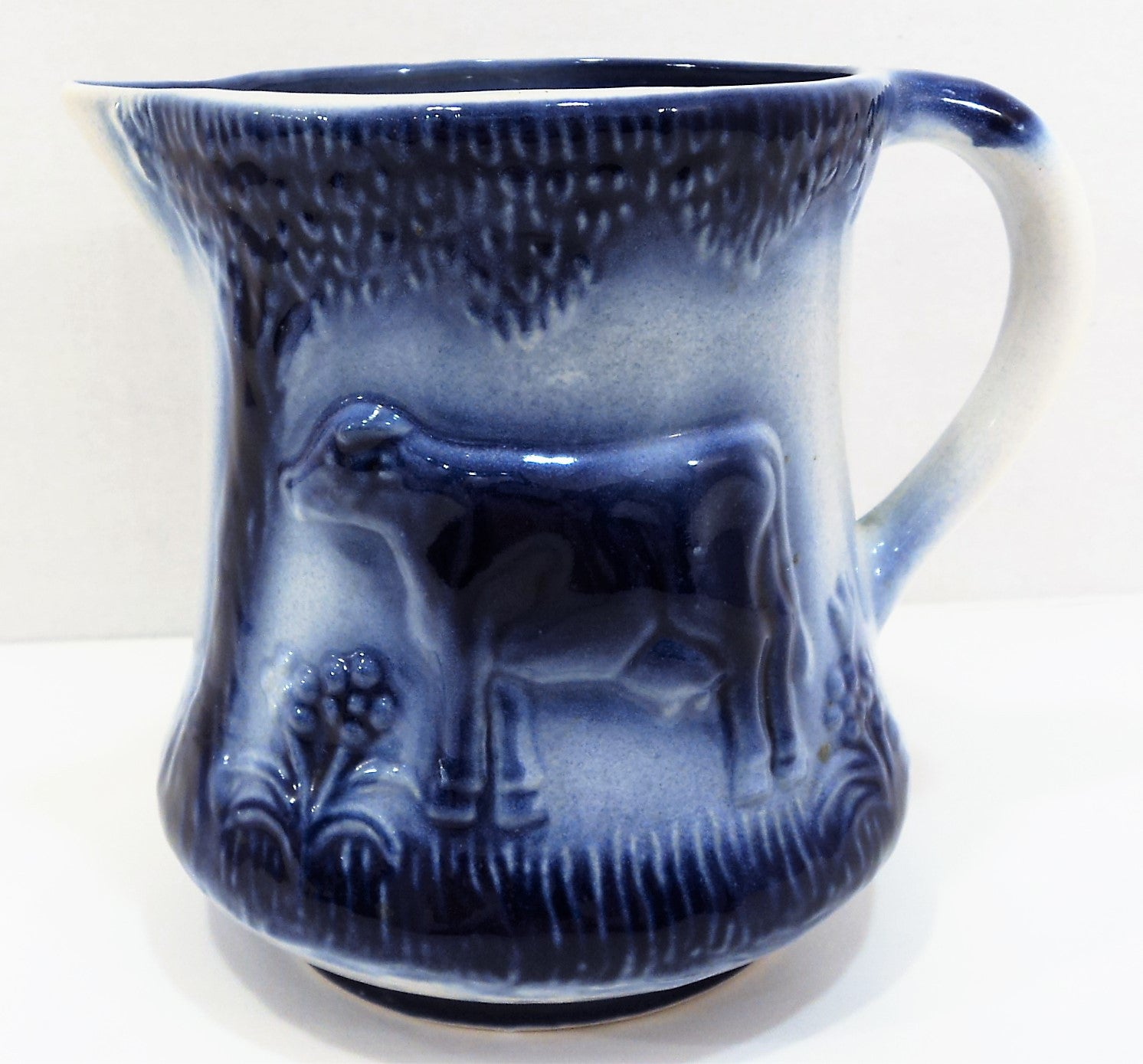 Flow Blue Pottery Pitcher