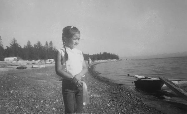 Cydney as 6 year old child on the bank of the Osoyoos Lake