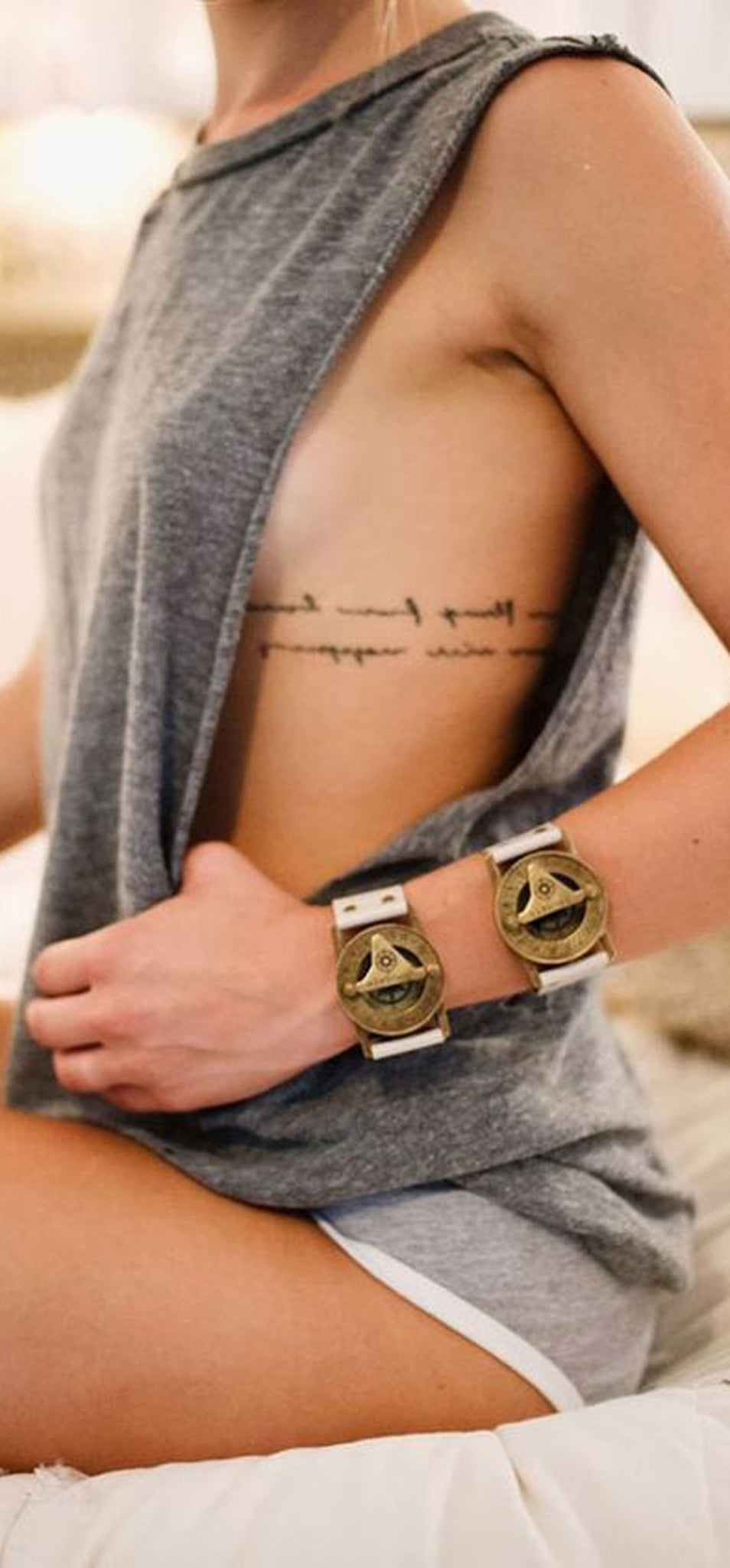 Small Script Rib Tattoo Ideas - Meaning Cursive Quote ideas de tatuajes - www.MyBodiArt.com