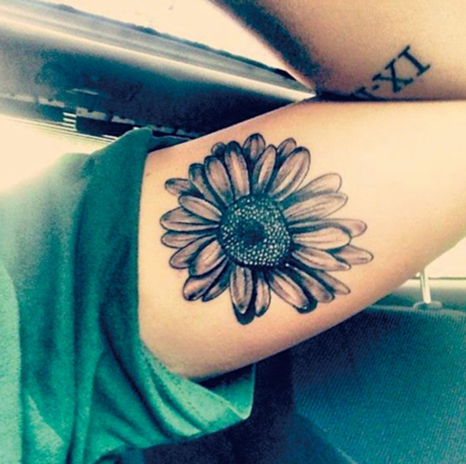 Black and White Sunflower Bicep Arm Tattoo Ideas for Women at MyBodiArt.com