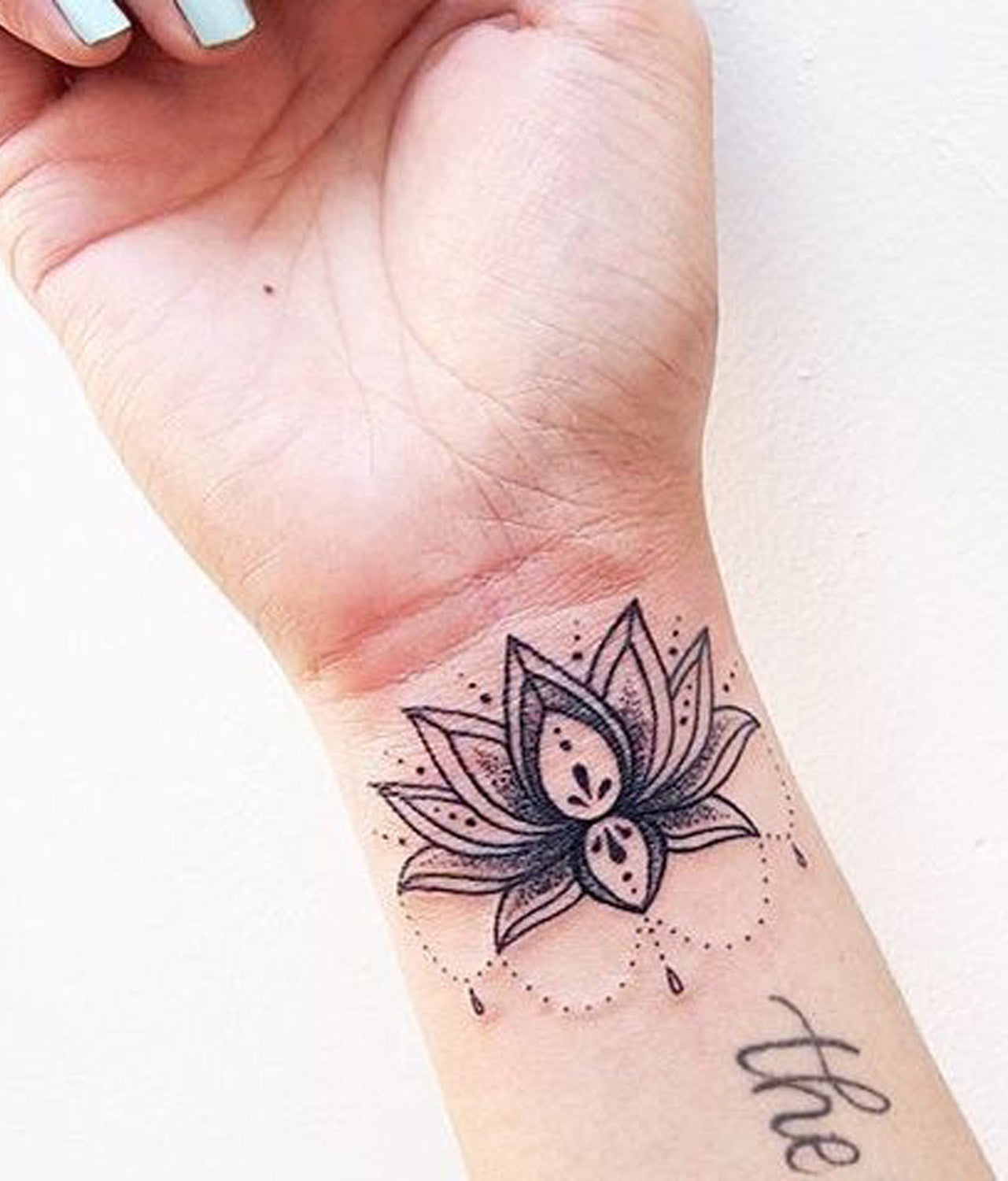 Large Black Lace Lotus Wrist Placement Tattoo Ideas at MyBodiArt.com