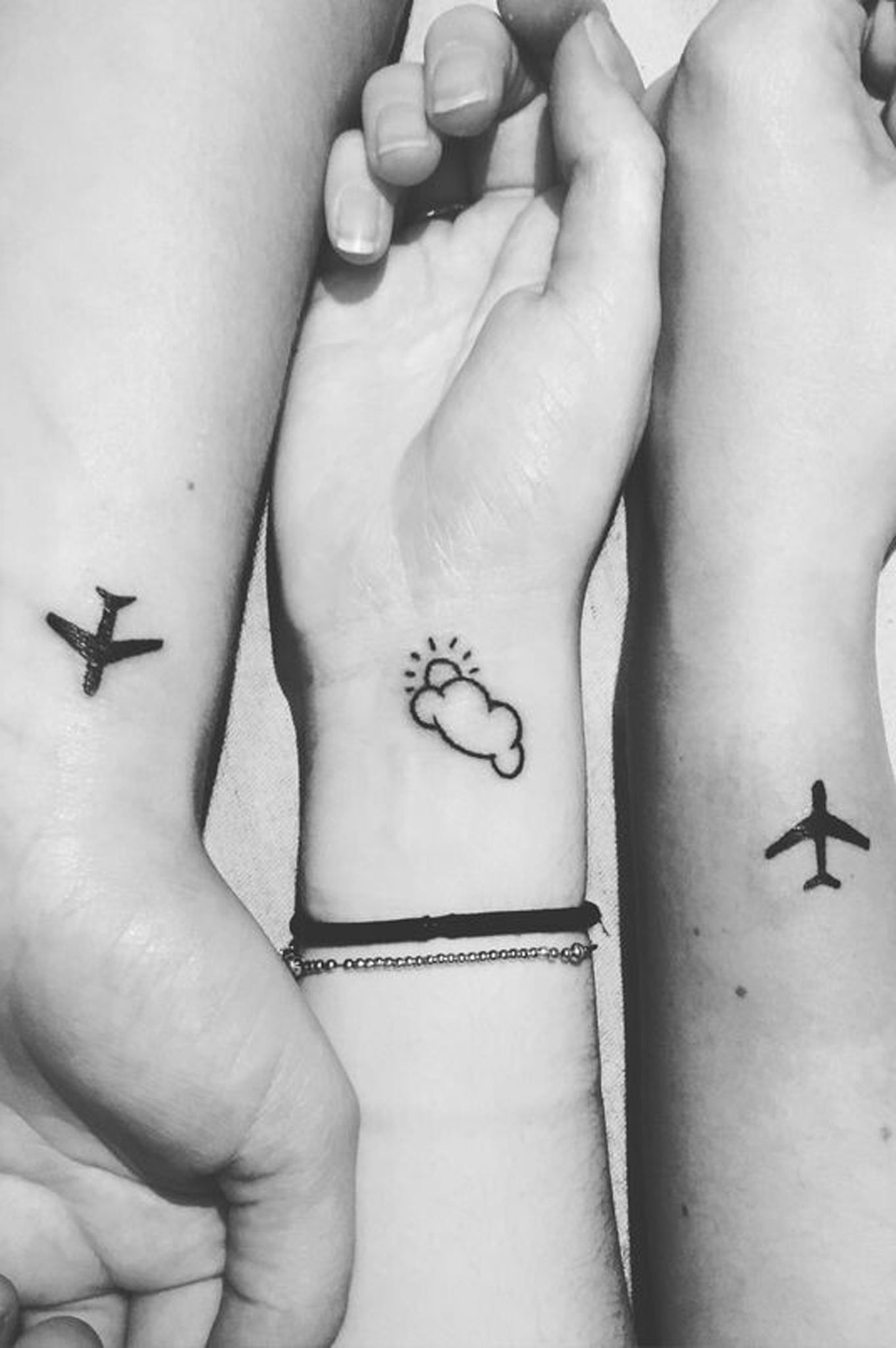 Small Simple Wrist Tattoo Ideas for Travelers - Airplane and Cloud Arm Tatt at MyBodiArt.com