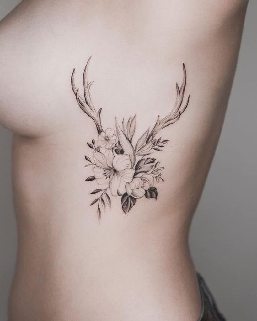 Unique Delicate Reindeer Floral Flower Rib Tattoo Ideas for Women - www.MyBodiArt.com