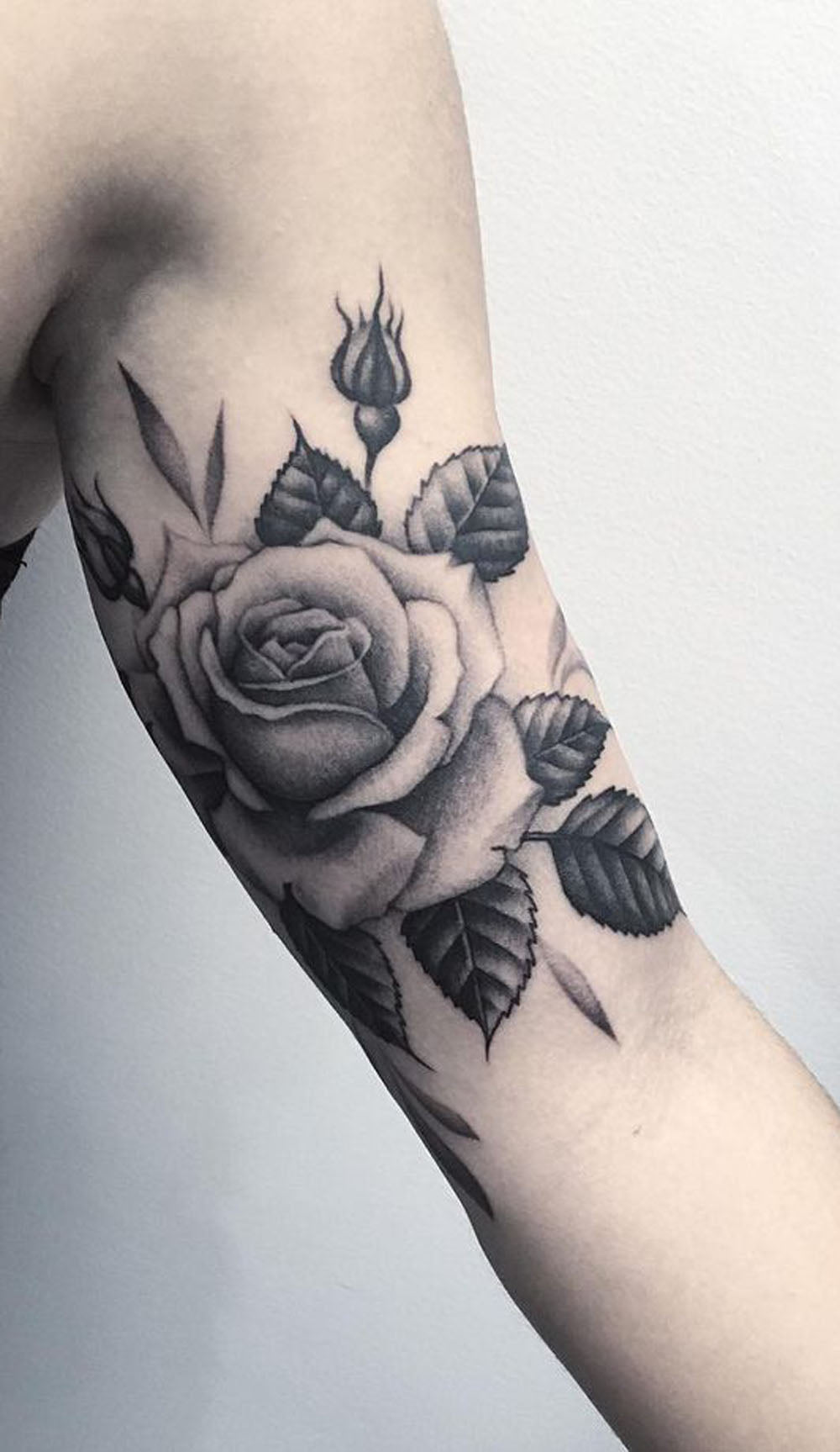 Realistic Black and White Rose Bicep Arm Tattoo Ideas for Women - www.MyBodiArt.com