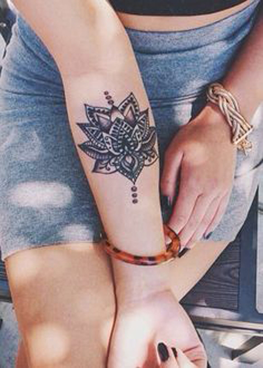 Beautiful Lotus Wrist Tattoo Ideas for Women at MyBodiArt.com