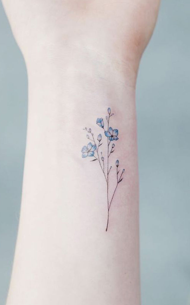 Wildflower Blue Watercolor Wrist Tattoo Ideas for Women -  Ideas de tatuaje de flores para mujeres - www.MyBodiArt.com