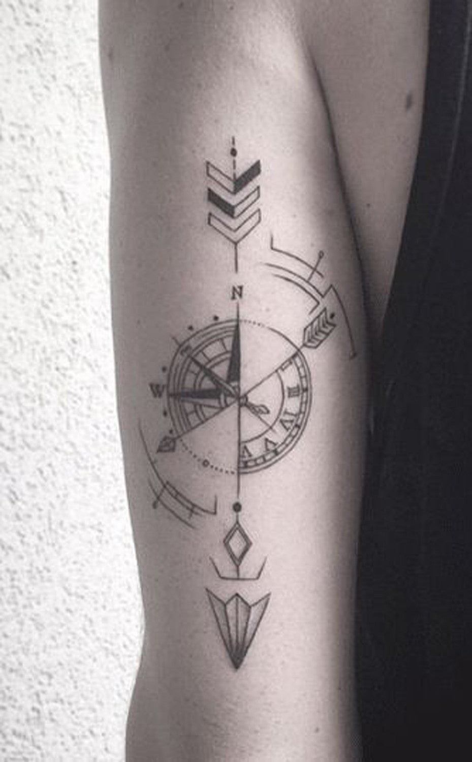 Compass Arrow Back of Arm Forearm Tattoo Ideas at MyBodiArt.com