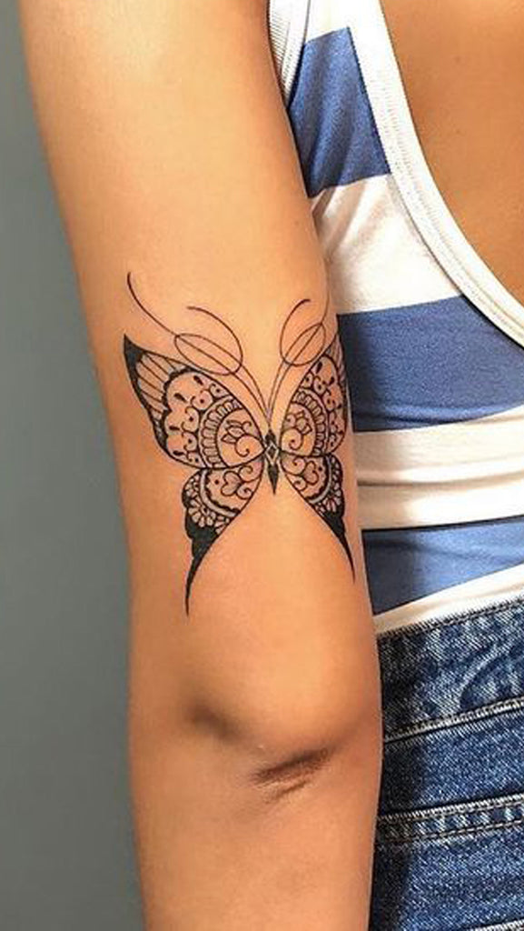 Small Black Butterfly Arm Tattoo Ideas for Women - www.MyBodiArt.com