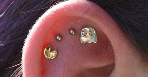 Can you guess what game inspired this cartilage / helix piercing ? Find the answer at MyBodiArt