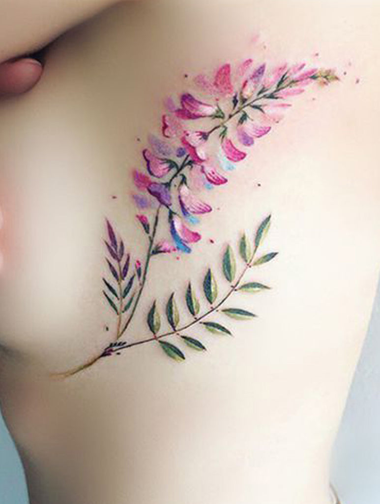 Watercolor Floral Flower Rib Tattoo Ideas for Women - www.MyBodiArt.com