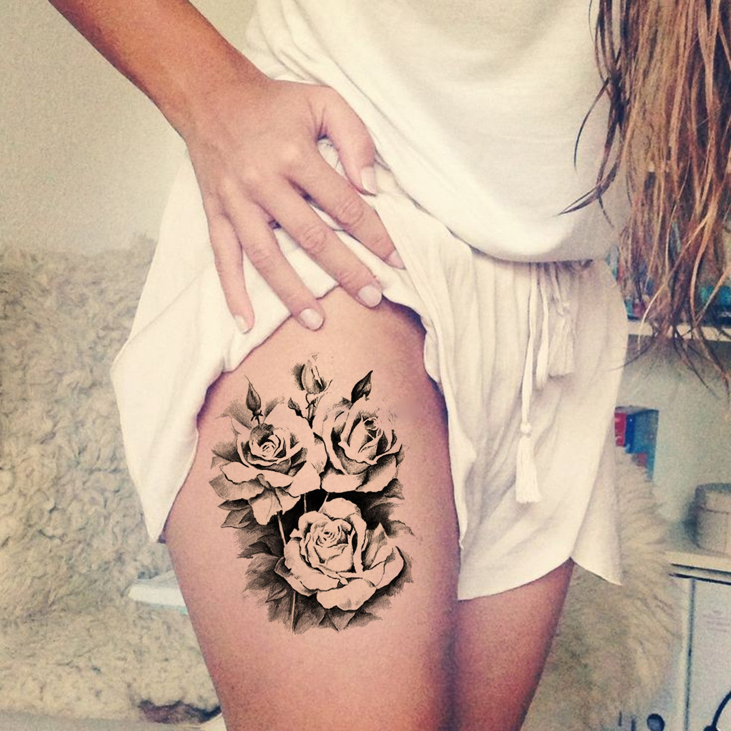 Black Flower Thigh Tattoo Ideas for Women at MyBodiArt.com