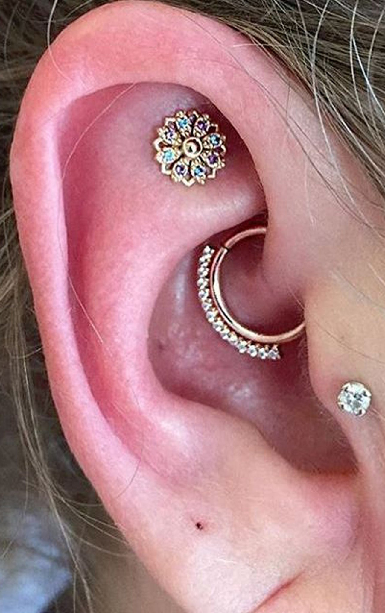 Celebrity Ear Piercing Ideas Combinations at MyBodiArt.com - Gold Daith Ring Hoop 16G - Constellation Earring - Tragus Stud