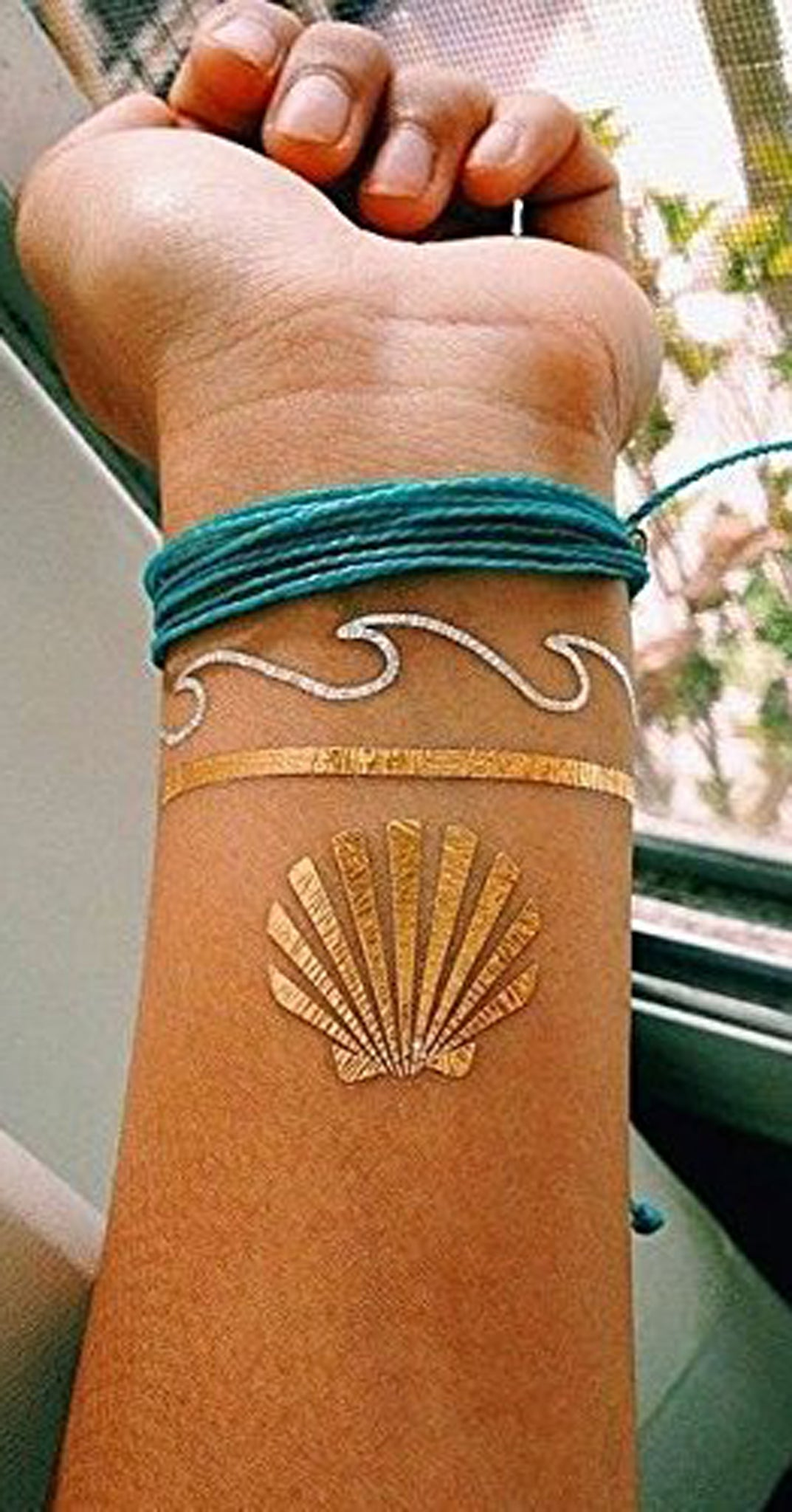 Seashell Tattoo Ideas for Women - Gold Metallic Sea Beach Flash Wrist Tat -  MyBodiArt.com