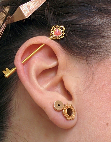 Gold Industrial Piercing Jewelry with Red Opal at MyBodiArt