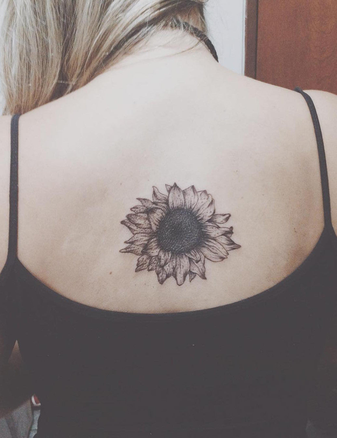 Small Black and White Floral Flower Sunflower Spine Tattoo Ideas for Women at MyBodiArt.com