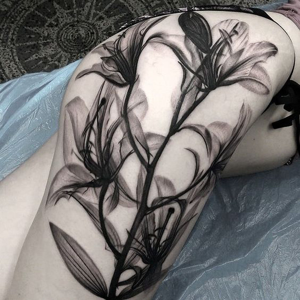 Black Floral Hip Tattoo - MyBodiArt.com