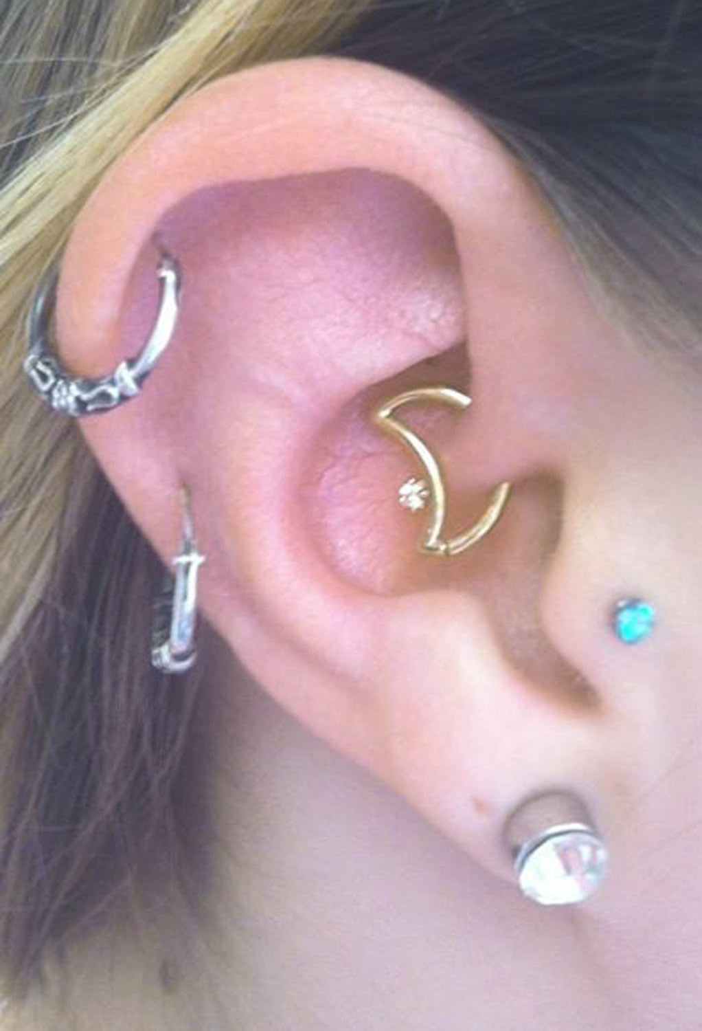 Most Gorgeous Multiple Ear Piercing Ideas at MyBodiArt.com - Cartilage Piercing Hoop, Moon Rook Earring, Tragus Stud, Helix Ring