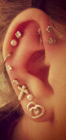 18 Adventurous Ear Piercings To Try This Summer