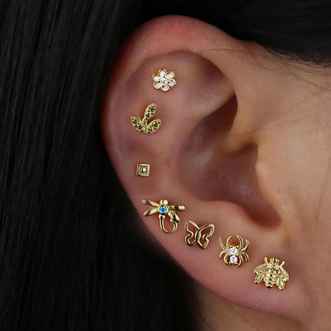 Pretty All The Way Around Ear Piercing Ideas - Gold Butterfly Earring Studs Jewelry for Cartilage Helix Lobe - www.MyBodiArt.com #tattoos