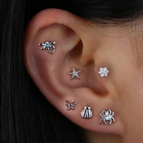 Pretty All The Way Around Ear Piercing Ideas - Silver Butterfly Earring Studs Jewelry for Cartilage Helix Lobe - www.MyBodiArt.com #tattoos
