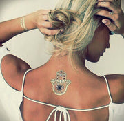 Boho Hamsa Back Tattoo Ideas for Women at MyBodiArt.com - Metallic Gold Hand Spine Tatt