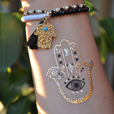 Small Tribal Wrist  Hamsa Tattoo Ideas for Women at MyBodiArt.com - Boho Gold Metallic Hand Tat with Evil Eye