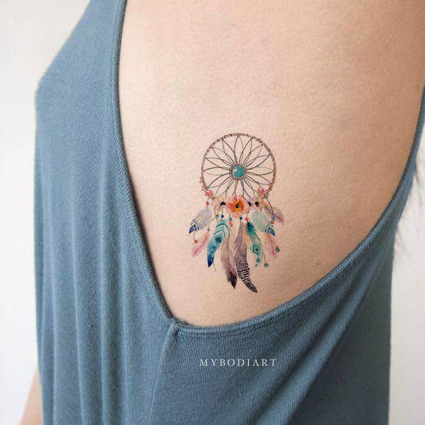 Beautiful Blue Watercolor Dreamcatcher Rib Tattoo Ideas for Women -  ideas de tatuajes de costillas de acuarela para mujeres - www.MyBodiArt.com