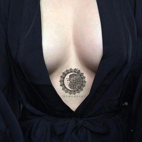 Cool Black Tribal Mandala Sternum Tattoo Ideas for Women - Sacred Geometric Moon Clevage Tat for Teen Girls - www.MyBodiArt.com #tattoos