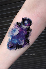 Cool Unique Watercolor Star Galaxy Space Astronaut Forearm Tattoo Ideas for Women - Ideas de tatuajes de antebrazo galaxy para mujeres - www.MyBodiArt.com #tattoos