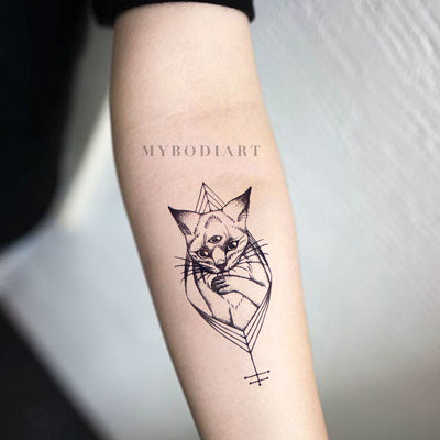 Small Tribal Egyptian Cat Forearm Tattoo Ideas for Women - Black Geometric Kitty Feminine Spirit Animal Arm Tat - www.MyBodiArt.com #tattoos