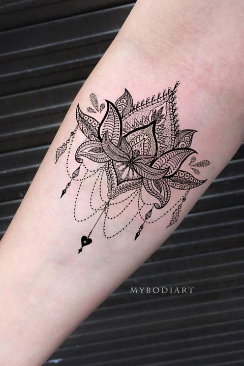 Black Tribal Boho Lotus Chandelier Forearm Tattoo Ideas for Women - www.MyBodiArt.com #tattoos