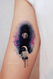 Cool Unique Watercolor Star Galaxy Space Astronaut Arm Bicep Tattoo Ideas for Women - Ideas de tatuajes de antebrazo galaxy para mujeres - www.MyBodiArt.com #tattoos