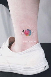 cute galaxy space small rainbow watercolor ankle planet tattoo ideas for women - www.MyBodiArt.com #tattoos