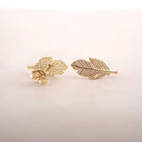 Simple Delicate Ear Piercing Ideas for Women - Minimalist Leaf Feather Earring Studs in Gold or Silver - ideas simples de piercing en la oreja - www.MyBodiArt.com #earrings