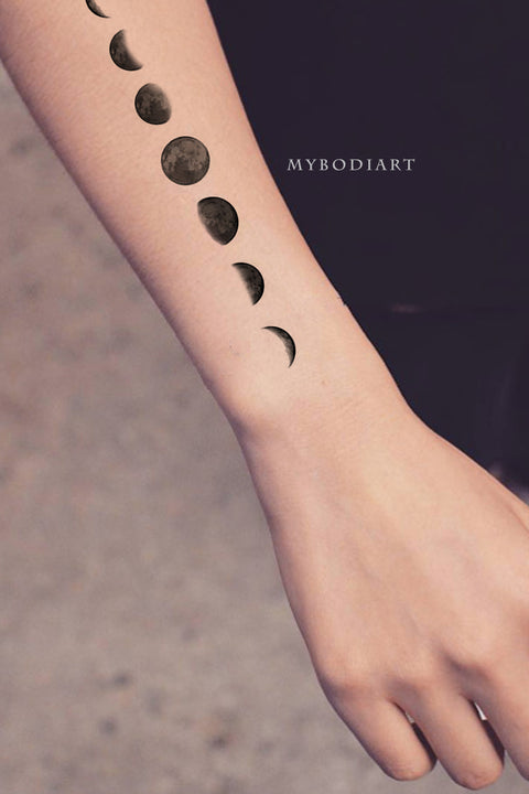 Cute planet moon phases black arm forearm tattoo ideas for women - Ideas de tatuajes de bíceps de brazo lunar para mujeres - www.mybodiart.com #tattooscom #tattoos
