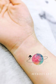 Popular Trending Small Watercolor Planet Moon Galaxy Space Wrist Tattoo Ideas for Women - ideas del tatuaje de la muñeca del planeta para las mujeres - www.MyBodiArt.com