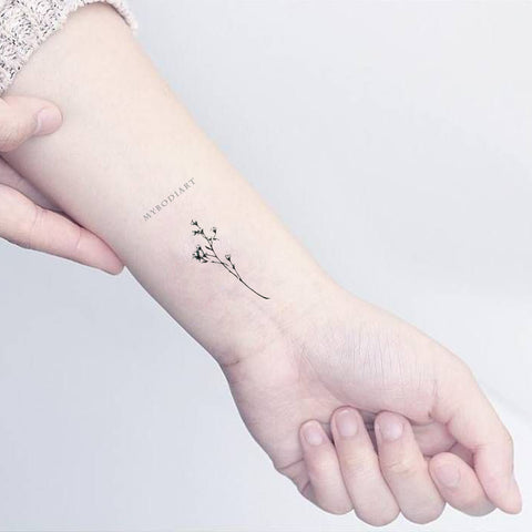 dainty branch leaf wrist tattoo ideas for females - www.mybodiart.com