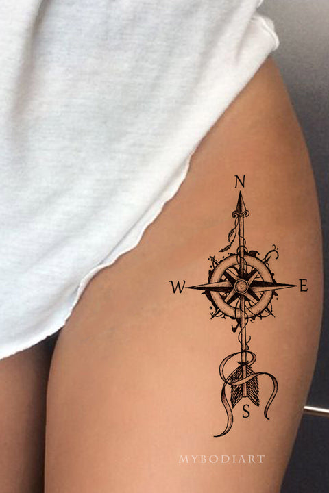 Popular Compass Arrow Thigh Tattoo Ideas for Women - Ideas de tatuaje de muslo para mujeres - www.MyBodiArt.com #tattoos