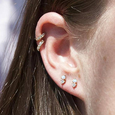 Cute Cartilage Ear Lobe Ear Piercing Ideas for Women Opal and Crystal Earring Studs for Women -  Ideas simples para perforar el oído - www.MyBodiArt.com