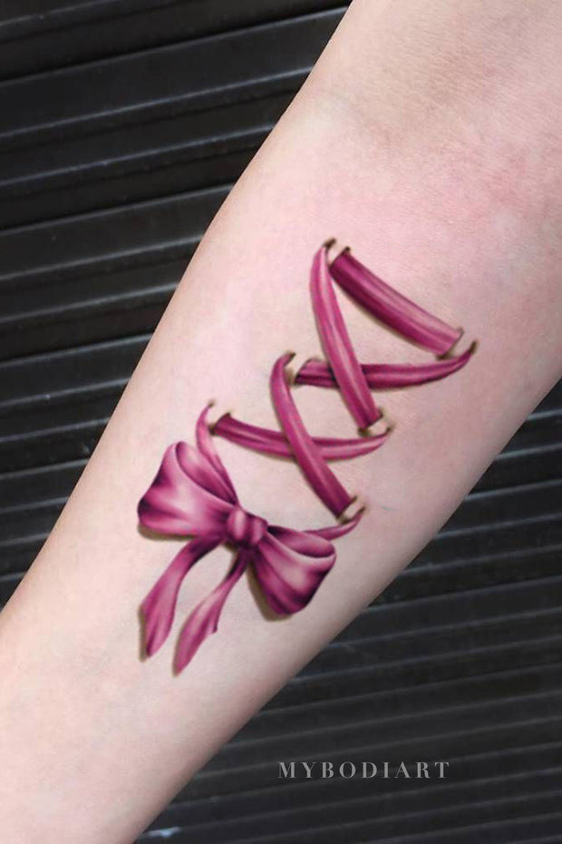 Cute Pink Watercolor Criss Cross Bow Tie Forearm Temporary Tattoo Ideas for Women - www.MyBodiArt.com