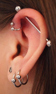 Cool Simple Multiple Ear Piercing Ideas at MyBodiArt.com - Double Lobe Earring - Industrial Barbell - Spiral Triple Forward Helix Ring - MyBodiArt.com