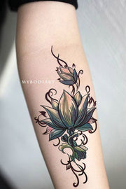 Lotus Arm Forearm Tattoo Ideas for Woman Tribal Boho Floral Flower Side Tat -  tatuaje de antebrazo de loto - www.MyBodiArt.com