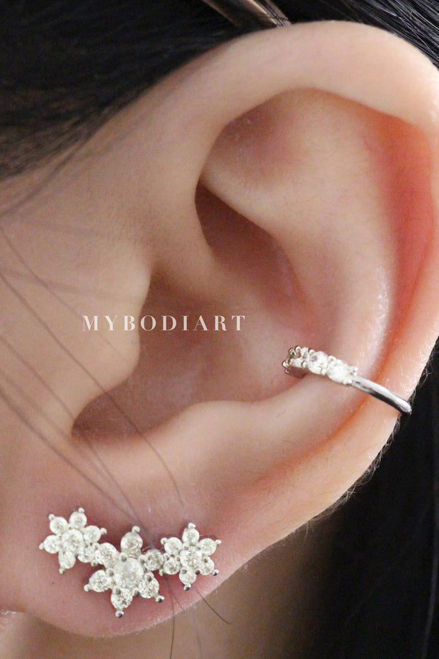 Cute Feminine Ear Piercing Ideas for Women Crystal Conch Cartilage Ear Cuff Triple Flower Earring Jewelry -  lindas ideas para perforar orejas - www.MyBodiArt.com