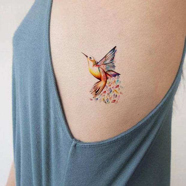 Watercolor Hummingbird Side Rib Tattoo ideas for Women - www.MyBodiArt.com #tattoos
