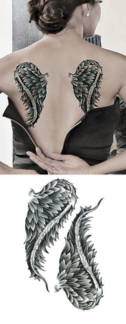 Feminine Angel Wing Back Tattoo Ideas for Women - angel wing ideas de tatuaje para mujeres - www.MyBodiArt.com #tattoos