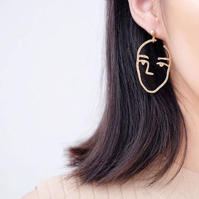 Abstract Artsy Ear Piercing Ideas - Hammered Metal Artistic Modern Portrait Face Dangle Earrings - www.MyBodiArt.com