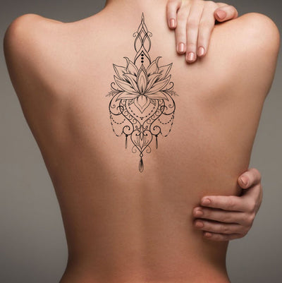 Bohemian Lotus Back Tattoo Ideas for Women - Feminine Tribal Flower Chandelier Jewelry Spine Tat - Ideas de tatuaje de espalda de mujer -  www.MyBodiArt.con #tattoo